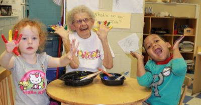Children and Elderly Woman Participating in Arts and Crafts