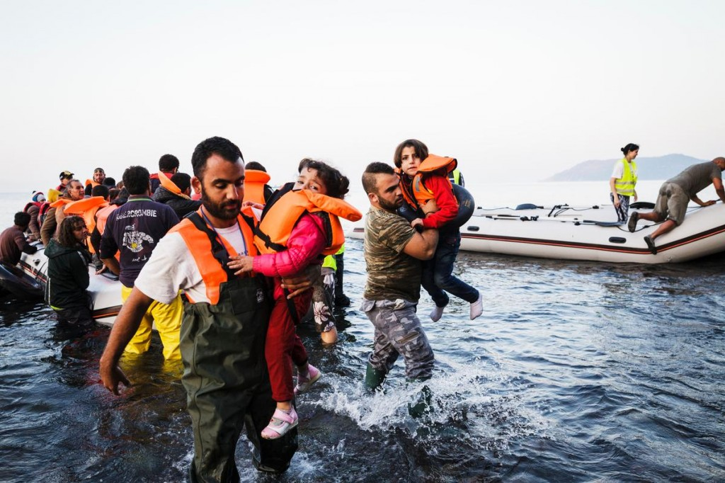 Greece. Refugees arrive on the shores of the island of Lesbos after crossing the Aegean sea from Turkey