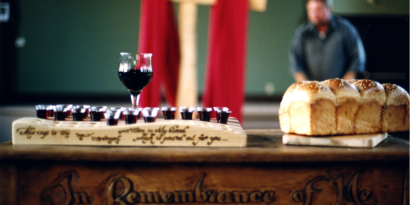 Close up of alter with wine and bread displayed