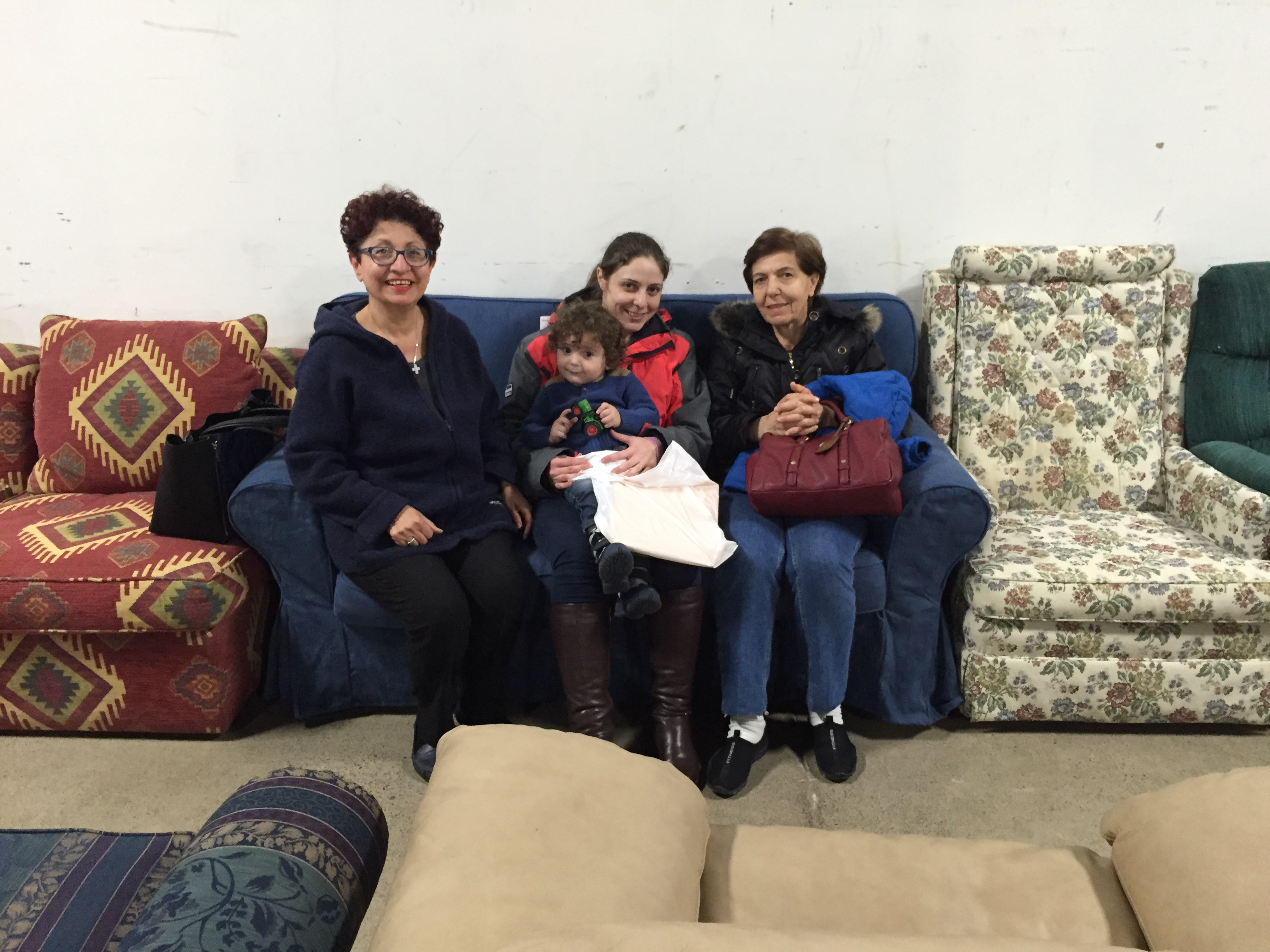 Syrian family with sofa they chose at Furniture Bank (1)