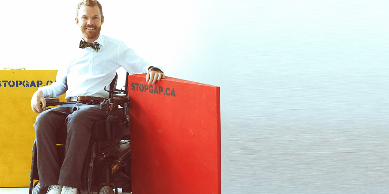 Head shot of Luke Anderson, Founder and Executive Director of StopGap Foundation in his wheelchair