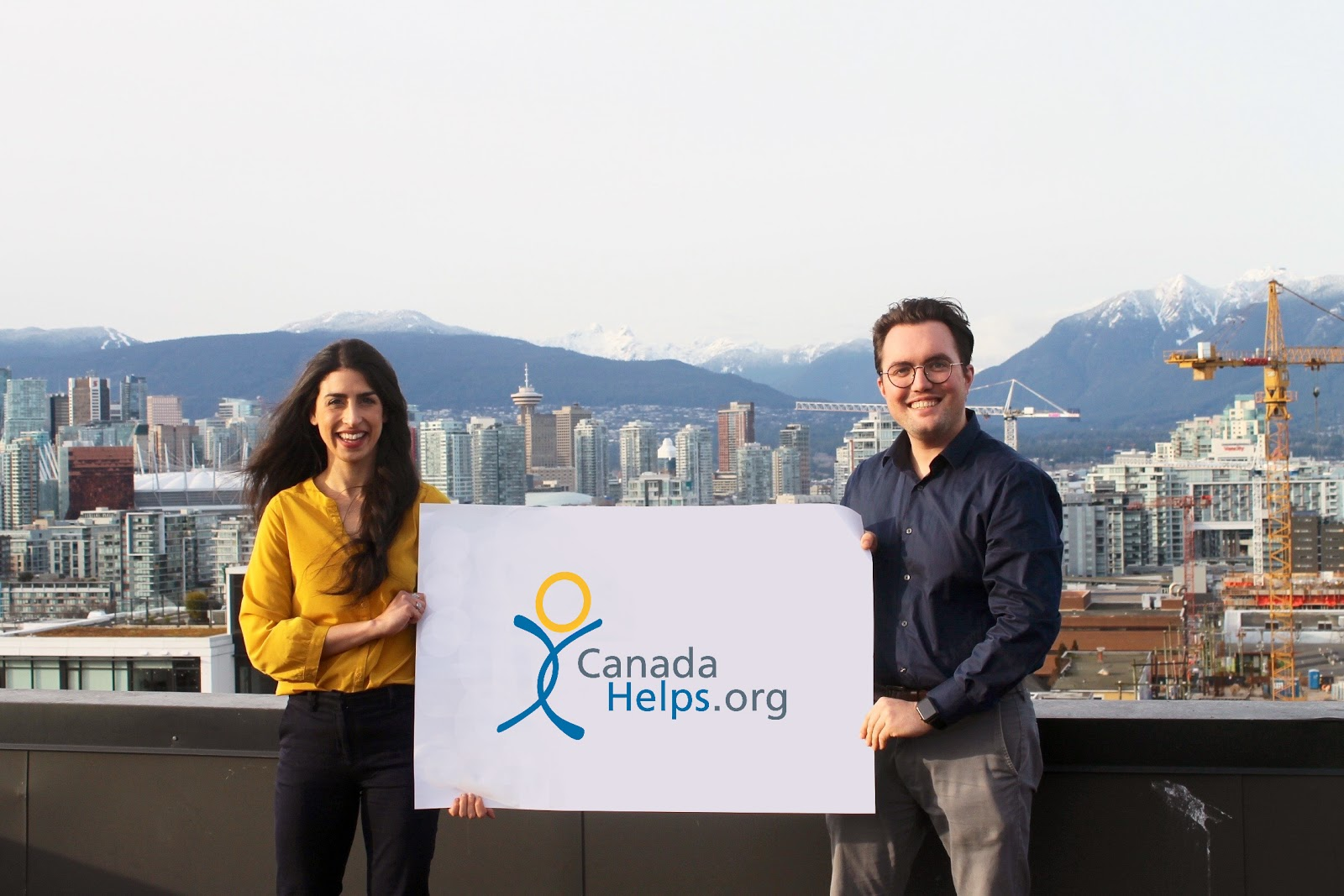 CanadaHelps Western Canada Charity Engagement team members with the B.C. mountains in the background.